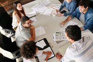 Dental marketing agency sitting around a table developing a content marketing strategy for a client