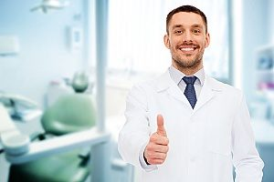 dentist holding a thumbs up after working successfully with a dental marketing agency