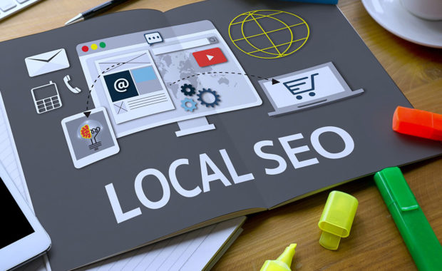 a gray book that shows an infographic about local SEO which is crucial for any insurance digital marketing strategy