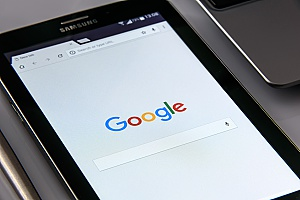 a businessman using Google on his mobile phone to test his Ashburn, VA SEO strategies