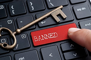 a key on a keyboard that says banned which represents the dangers of malicious search engine optimization techniques
