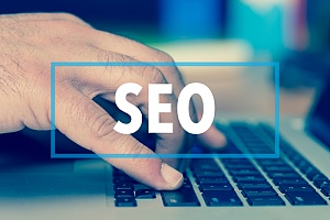 hand searching top 5 benefits of seo services for small businesses