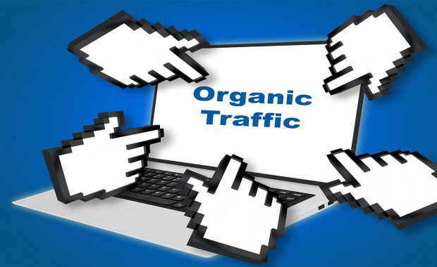 Organic Traffic concept with pointing hand icons pointing at the laptop