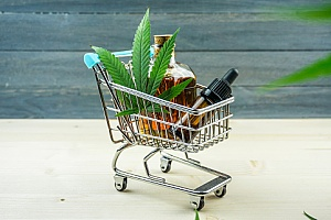 a small shopping cart with cannabis products to represent a dispensary marketing plan