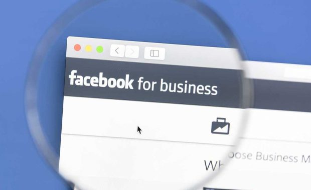Magnifying glass looking at the Facebook for Businesses page