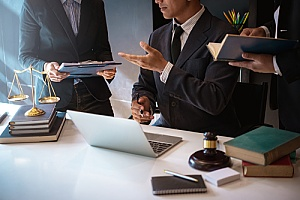 a law firm holding a meeting about potentially acquiring digital marketing services