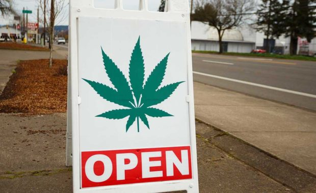 Open sign for dispensary who read how to market your dispensary in 2021