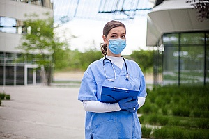 a healthcare employee who is working outside during a pandemic